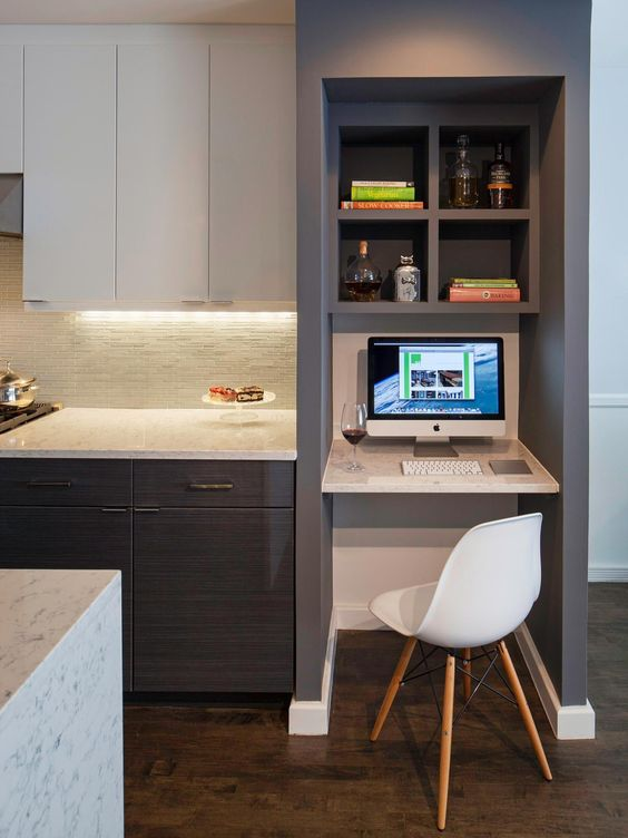 A Contemporary Kitcen In Grey And White With Separated Office Nook Built
