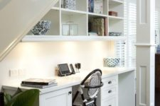 18 a large wall-mounted cabinet with open storage and built-in lights is a great idea for such a nook