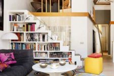 18 a white staircase with built-in bookshelves – the whole staircase functions as a bookcase