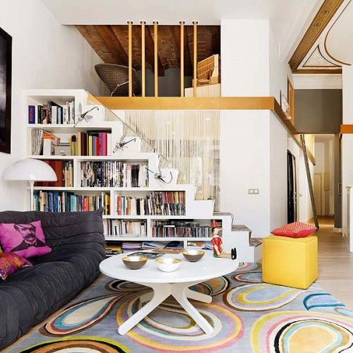 a white staircase with built-in bookshelves - the whole staircase functions as a bookcase