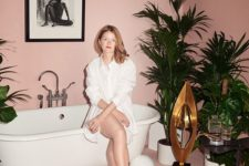 18 an all-pink bathroom with tropical plants in pots and artworks for a glam girl