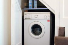 18 even a small staircase can accommodate a tiny laundry like this one