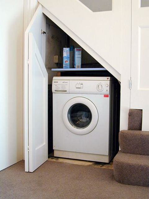 even a small staircase can accommodate a tiny laundry like this one
