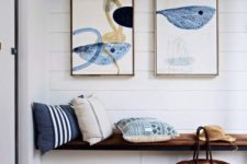 19 a built-in bench with storage, watercolor artworks over the bench, printed pillows for a simple look