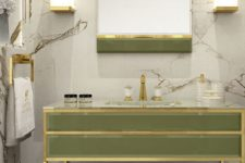 19 a chic light green vanity and mirror with brass touches are ideal for a luxurious space