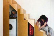 19 a little laundry and a storage space incorporated into the under stairs space