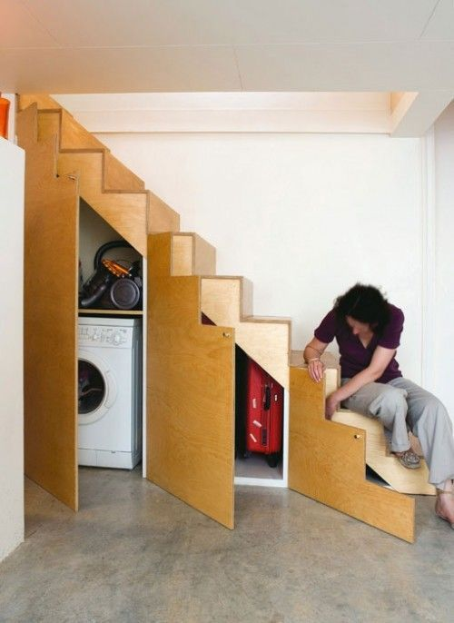 a little laundry and a storage space incorporated into the under stairs space