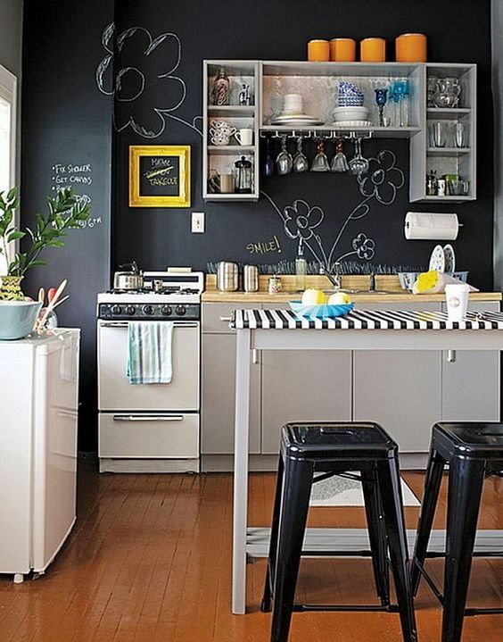 a whole chalkboard wall inspires creativity and chalking on it - both kids and adults will have fun