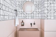 19 pink panels and a sink contrast the geometric black and white tiles and create a unique space