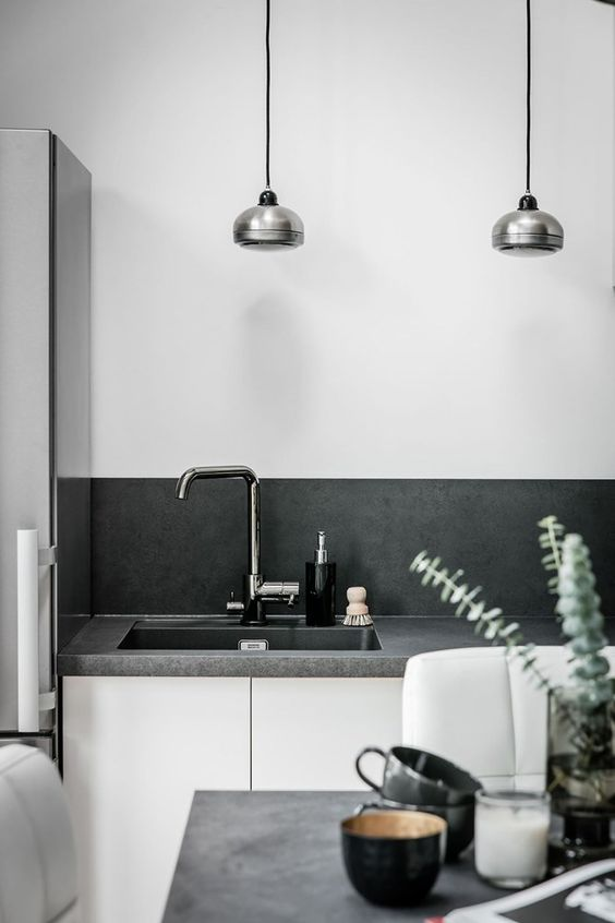a Scandinavian space with a concrete countertop and backsplash that look very stylish and neat
