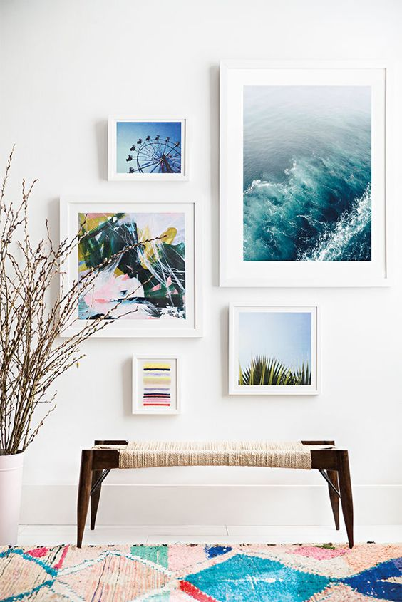 a beach entryway with a woven bench and beach-inspired artworks to welcome visitors