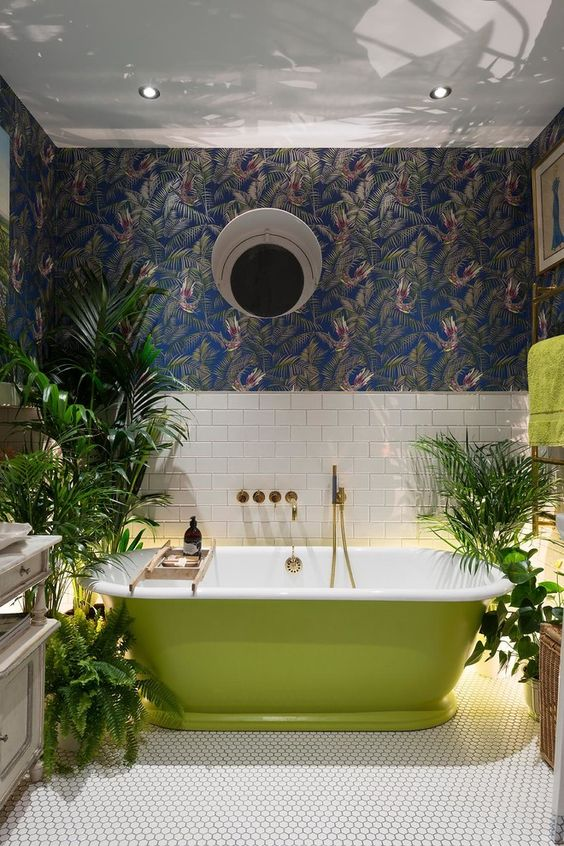 a creative bathroom design with a grass green free-standing bathtub and living greenery in pots
