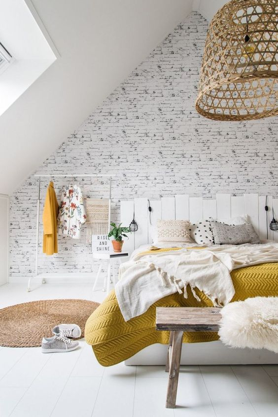 a neutral space spruced up with a wicker lampshades, a just rug, yellow touches here and there