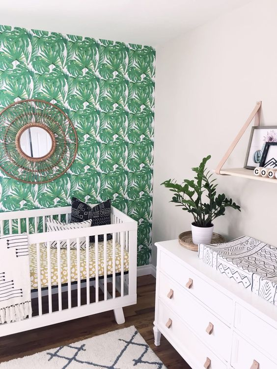 a palm leaf print statement wall, a woven mirror, printed textiles and white furniture