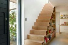 20 a wooden staircase with books inside is a creative and practical way to store them all