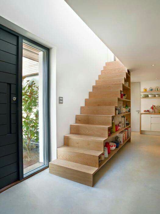 a wooden staircase with books inside is a creative and practical way to store them all