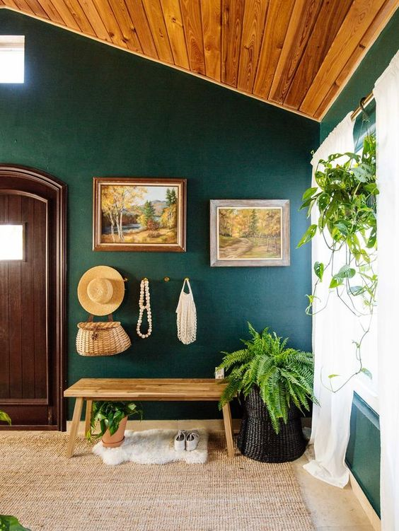 rock green shades and real greenery for an entryway to make it welcoming and embracing