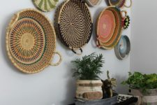 21 a boho woven and wooden bench, an arrangement of colorful baskets and basket planters