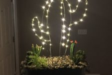 21 a gorgeous arrangement with cacti, succulents and a LED cactus with a flower on top