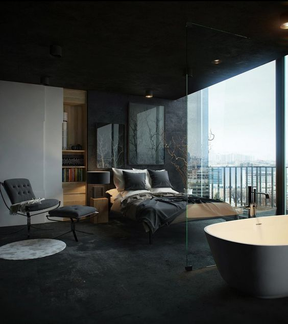 a sexy masculine bedroom with a glazed wall and a free-standing bathtub spearated with a glass divider
