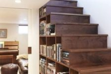 21 a wooden staircase with compartments for storage filled with books