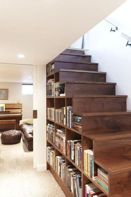 a wooden staircase with compartments for storage filled with books