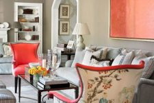 21 bold chairs with coral fronts and printed backs plus a coral artwork to match the look