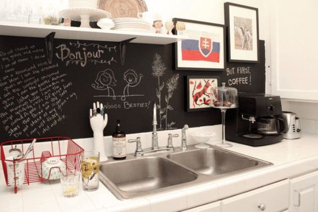 create a bold contrast with white cabinets and countertops and a chalkboard backsplash