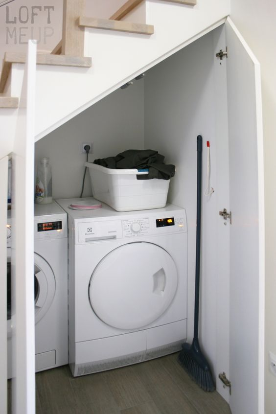 place a laundry under the stairs, there's enough storage space even for chemicals