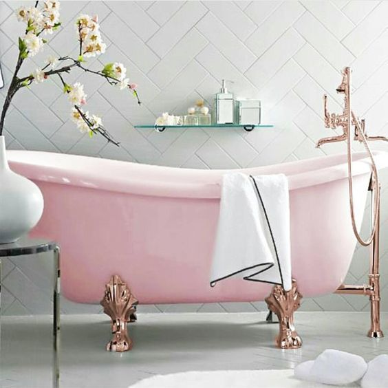 a refined pink bathtub with copper clawfoot legs for a gorgeous and sophisticated space