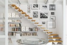 22 an airy whitewashed Scandinavian space with floating bookshelves under the stairs
