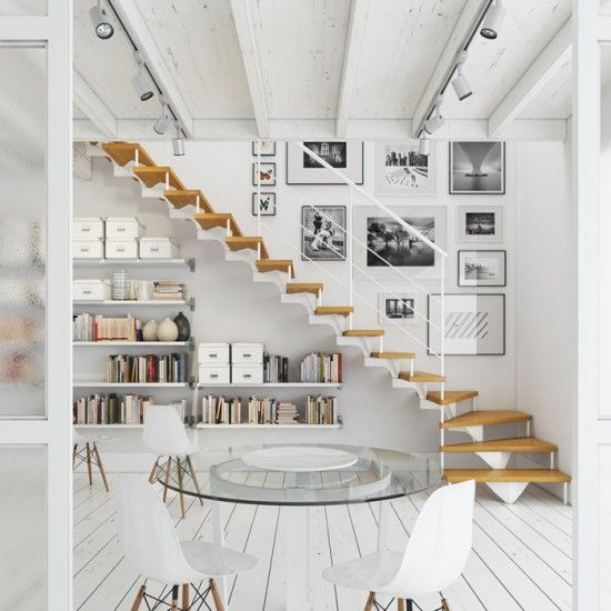 an airy whitewashed Scandinavian space with floating bookshelves under the stairs