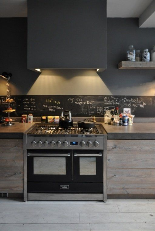 light-colored wooden cabinets, concrete countertops and a narrow chalkboard backsplash for a texture