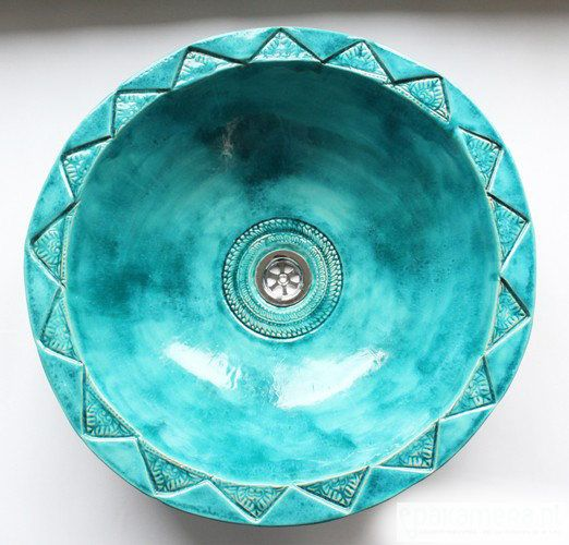 a gorgeous Moroccan turquoise sink with textural patterns is a fantastic way to make a statement