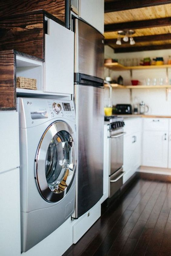 a washer and dryer combo unit built in under the stairs to save some space