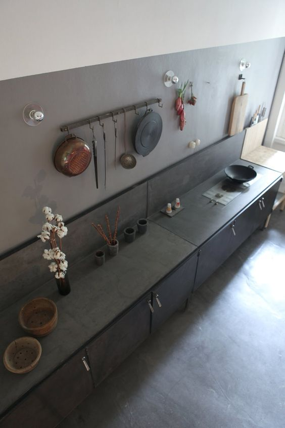 black metal cabinets and a grey reinforced concrete backsplash and countertop for an industrial look