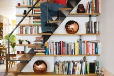 23 bookshelves built in into the staircase itself – use the steps for sitting there