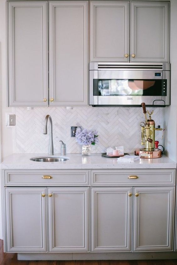 elegant marble tiles clad in a chevron pattern is a chic and elegant idea suitable for a traditional kitchen