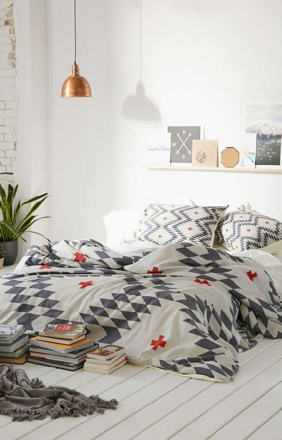 printed bedding in white, grey and red for a touch of print and color to the room