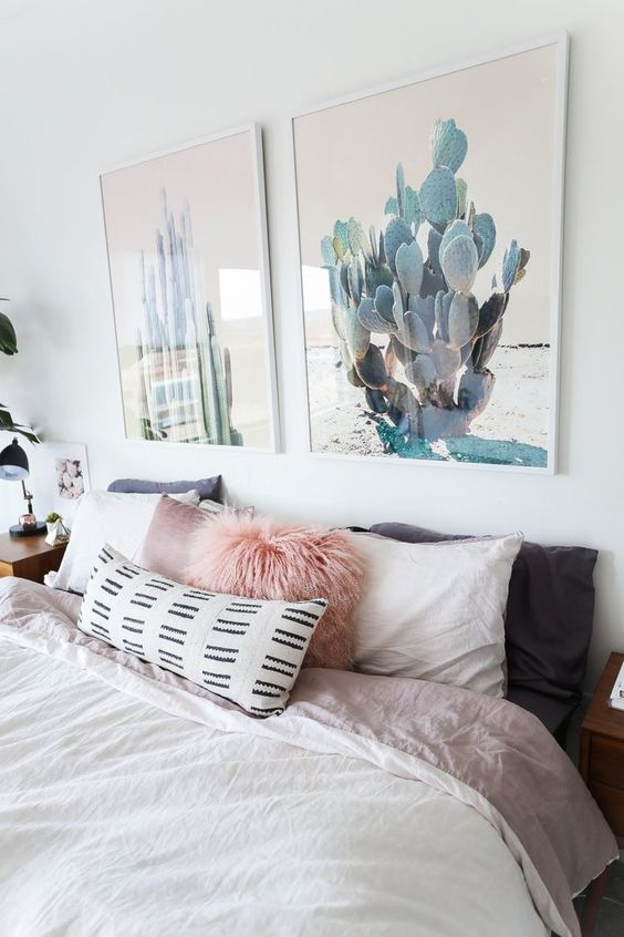 an amazing duo of cactus artworks is a chic way to bring a slight boho feel to the space