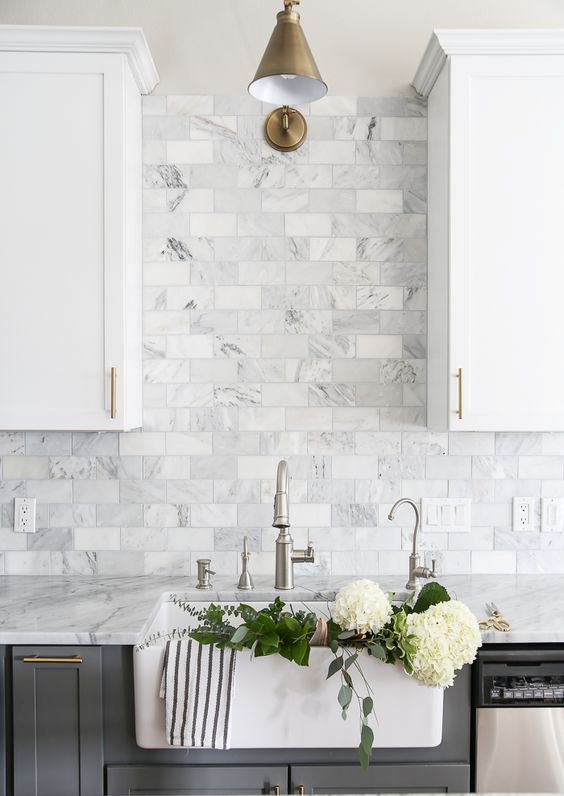 grey marble subway tiles are ideal for a two-toned grey and white kitchen and add a refined feel to it