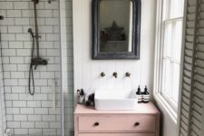 25 a dusty pink sink console table adds a touch of color and interest to the neutral bathroom