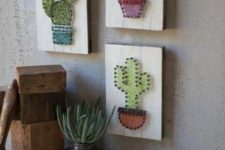25 an arrangement of string artworks with cacti, string art pieces are extremely popular