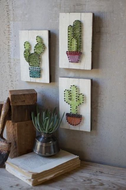 an arrangement of string artworks with cacti, string art pieces are extremely popular