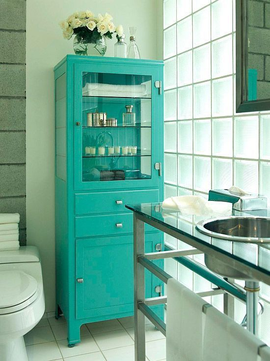 an old-fahsioned pharmacy cabinet redone with a bold color - turquoise, gets a new life and a fresh feel