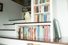 25 bookshelves built-in right into the staircase to use every inch of space