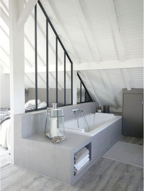 you may separate the bathtub zone with a stylish framed glass divider for more privacy