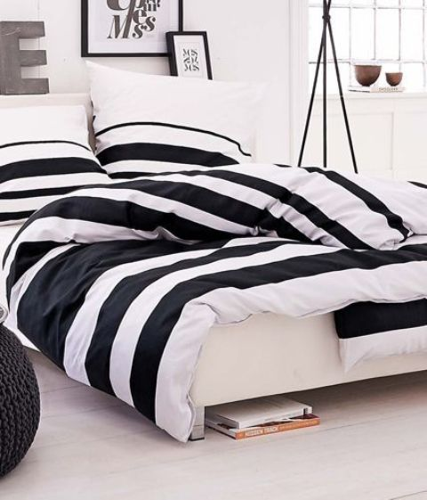 black and white striped bedding is a timeless idea to add a print to the space and it will work for any season