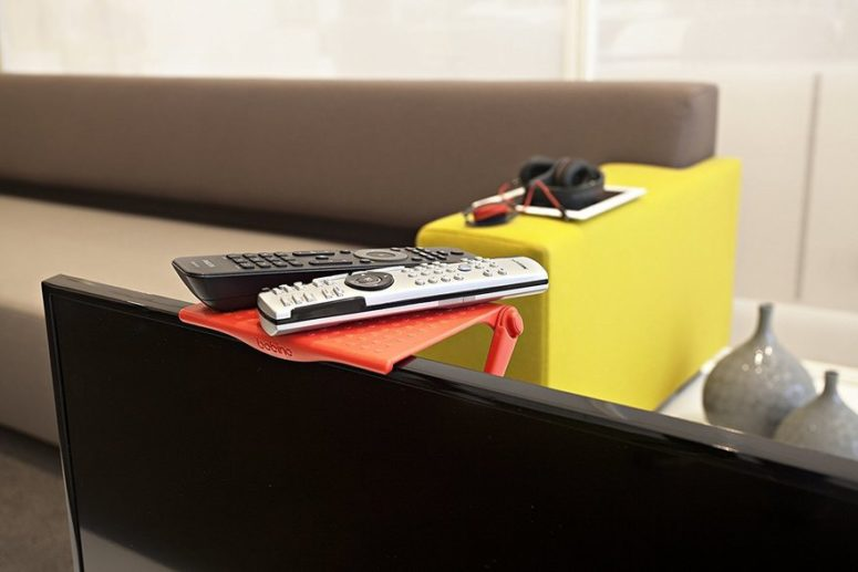 Bobino shelf uses dead space above your screen for storage of small items and accessories