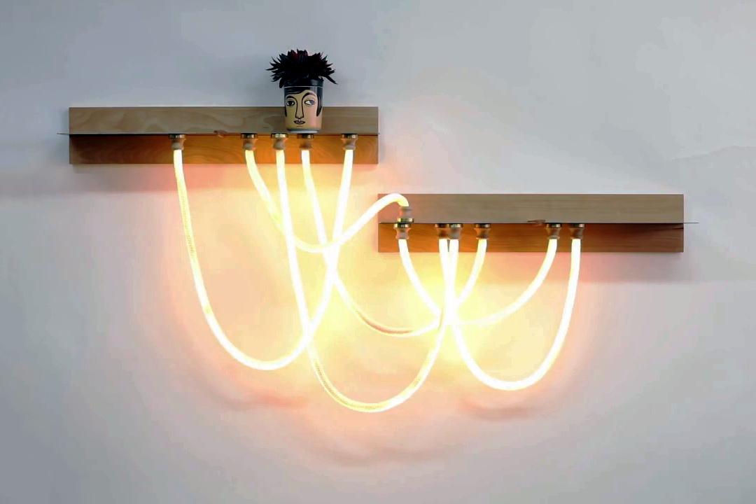Click Light features unique design and works as a shelf, too